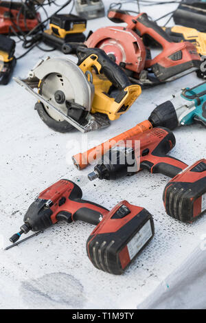 Power drills and saws on table - Stock Image