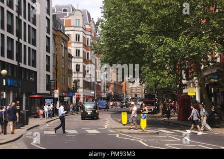 View along Charing Cross Road London summer 2018 - Stock Image