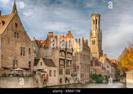 Bruges buildings, canal and belfry in November sunshine - Stock Image