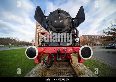Braunschweig, Germany, December 30., 2018: Steam locomotive in front of the main station, coal-fired German locomotive from 1939, front view - Stock Image