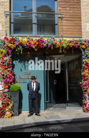 Entrance to The Varsity Hotel & Spa with doorman in bowler  Thompsons Lane Cambridge 2019 - Stock Image
