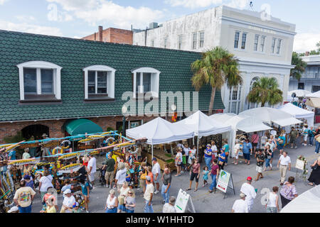 Mount Dora Florida Mt. Annual Craft Fair special event community street festival vendor tent crowd shopping outdoor building ove - Stock Image