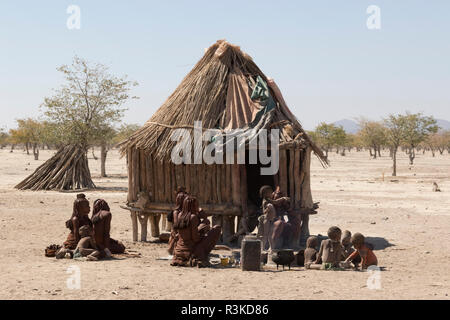 Africa, Namibia, Opuwo. Lunch time meal for Himba villagers. Credit as: Wendy Kaveney / Jaynes Gallery / DanitaDelimont.com - Stock Image