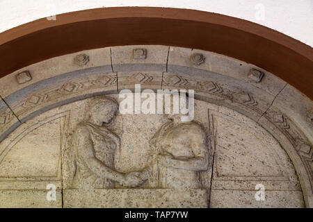 Sculpture depicting a man and woman on the marriage portal of the Lutherkirche in Wiesbaden, Germany. - Stock Image
