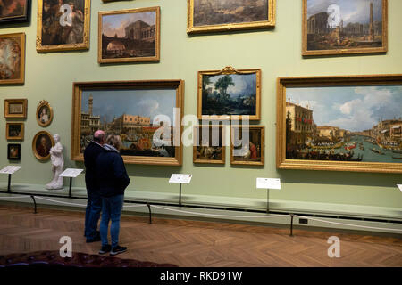 A senior couple viewing  Canaletto paintings in the Art Gallery at the Bowes Museum Barnard Castle Co.Durham England - Stock Image