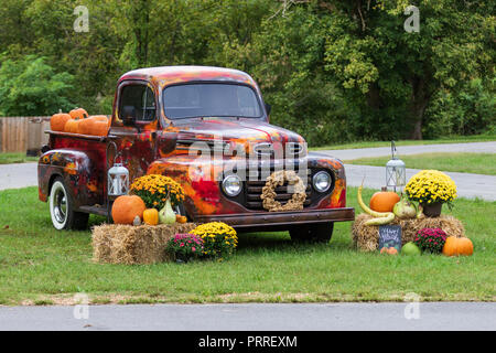 LIMESTONE, TN, USA-9/30/18:  An early 50s Ford pickup is displayed with pumpkins, showing of its elaborate paint job. - Stock Image