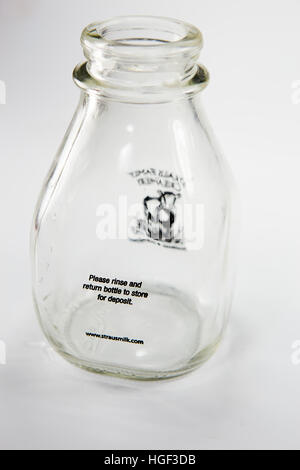 reusable clear glass cream bottle with a returnable store deposit  (Rinse and return bottle to store for deposit) - Stock Image