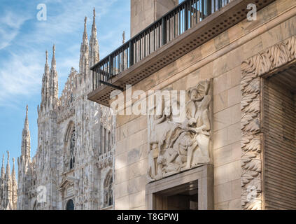 Exterior architectural details of Milan Cathedral (Duomo) and Museo del Novecento, Piazza del Duomo, Milan, Italy. - Stock Image