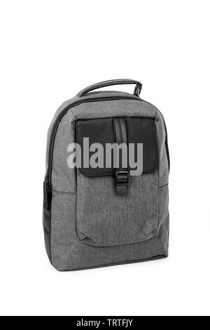 closeup of an elegant gray and black backpack in a white background - Stock Image