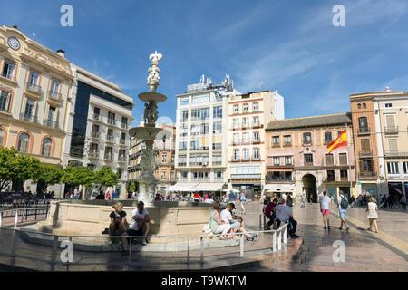 Plaza de la Constitucion, Constitution Square, Malaga, Costa del Sol, Malaga Province, Andalusia, southern Spain.  The fountain is the Fuente de Genov - Stock Image