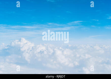 Above the clouds with blue sky - Stock Image