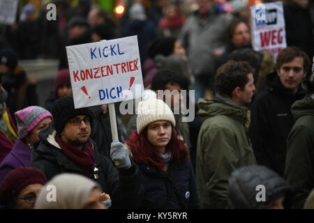 Vienna, Austria. 13th Jan, 2018. protester holding a sign critical of Austria's interior minister Herbert Kickl, - Stock Image