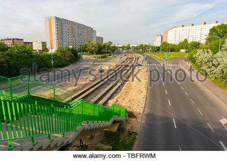 Stairs leading to the Zegrze road with tram track - Stock Image