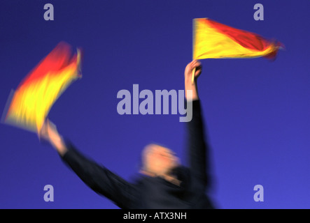 Business woman in motion waving signal flags - Stock Image