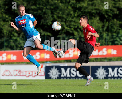Stadium Carciato, Dimaro, Italy. 13th July, 2019. Pre-season football freindly, Napoli versus Benevento; Marko Rog of Napoli is challenged by Dejan Vokic of Benevento Credit: Action Plus Sports/Alamy Live News - Stock Image