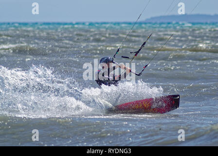 Kite boarder in the waves during a windy day in french riviera - Stock Image