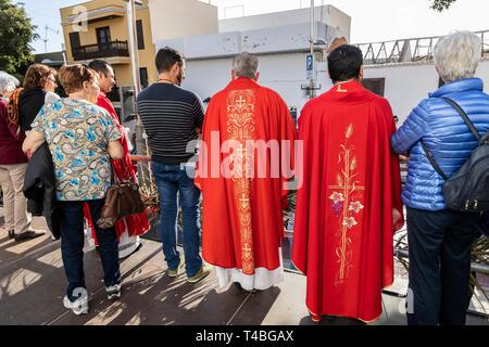 Priests in red robes watching the Pasión de Los Niños, Passion of the children,  Procesión de Los Pasos Chicos, Procession of the small stations of th - Stock Image