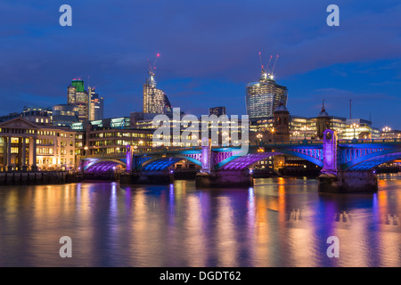 City of London and Southwark Bridge at night - Stock Image