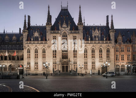 Exterior architecture of the Provincial Court building at sunrise, Markt, (Market Square), Bruges, Flanders, Belgium - Stock Image