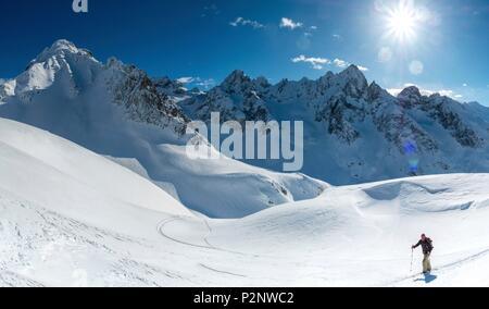 France, Haute Savoie, Chamonix, snowboarder hiker climbing towards the Brèche de Bérard - Stock Image