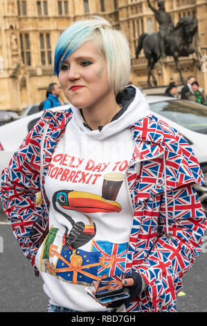 London, UK. 9th January 2019. A young woman wears a t-shirt stating that it is a 'Lovemly Day to Stop Brexit' and a union flag jacket. Protests by stop Brexit group SODEM (Stand of Defiance European Movement) and pro-Brexit campaigners continued opposite Parliament.. Credit: Peter Marshall/Alamy Live News - Stock Image