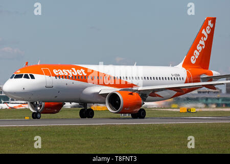 Easyjet Airbus A320 NEO aircraft, registration G-UZHR, taking off at Manchester Airport, England. - Stock Image