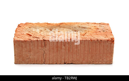 Single red clay brick isolated on white - Stock Image