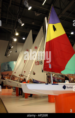 row od sailing dingies with bright couloured sails - Stock Image
