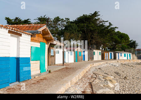 tiny colorful houses made of wood on the beach near la rochelle - Stock Image