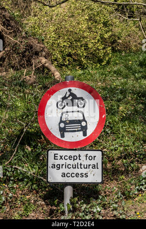 Sign post, no vehicles, vehicular access except agricultural access. - Stock Image