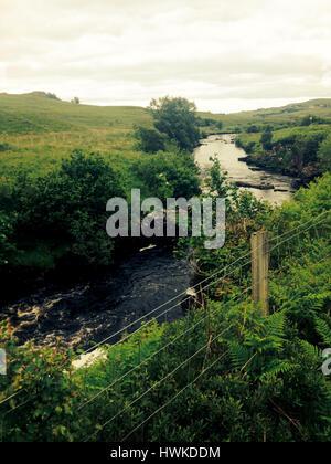 stream running through Portree Scotland - Stock Image