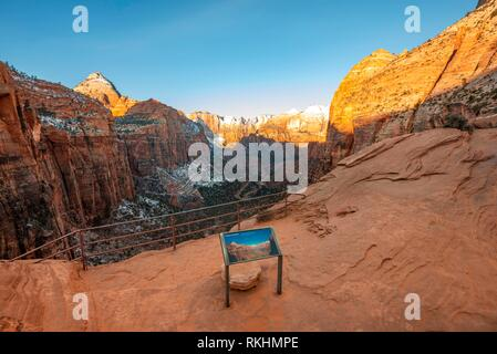 Canyon Overlook Viewpoint with view into the Zion Canyon with snow, at sunrise, back left Bridge Mountain, Zion National Park - Stock Image