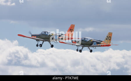 Two Finnish Air Force Valmet L-70 Vinka basic trainer aircraft flying at the 100 years anniversary Air Show of the FAF at Tikkakoski, Finland. - Stock Image