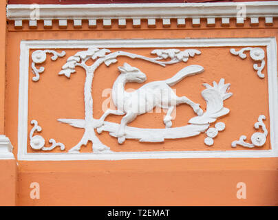 Ornat and decorative fretwork and cornice work on wall of Peranakan terrace house on Koon Seng Road, Joo Chiat,  Geylang, Singapore. - Stock Image