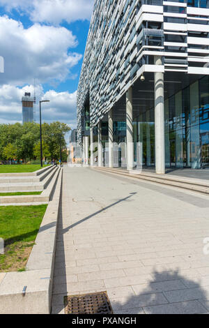 One of the Deansgate Square towers seen from the Brooks Academic building, Birley Campus, Manchester, England, UK. - Stock Image