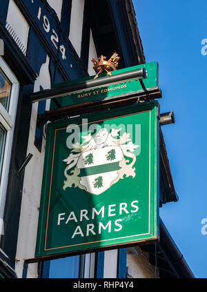 Exterior sign for the Farmers Arms public house part of the Greene King chain Wallasey Village February 2019 - Stock Image