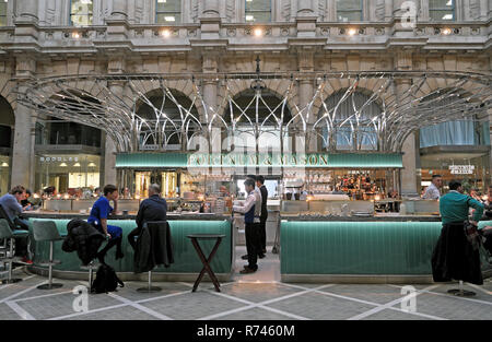 Fortnum & Mason sign and customers at the bar inside the Royal Exchange in the City of London during Christmas in England UK  KATHY DEWITT - Stock Image
