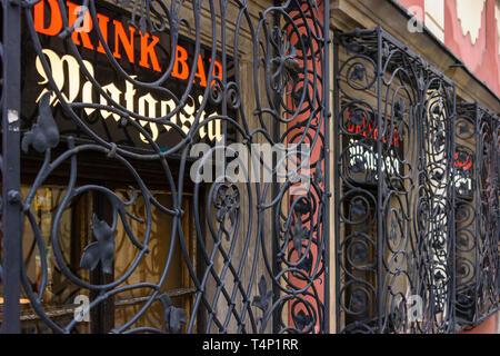 Ornate window bars outside an old pub, Wrocław, Wroclaw, Wroklaw, Poland - Stock Image