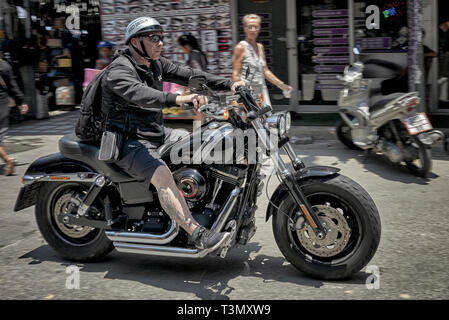 Biker riding a Harley Davidson motorbike - Stock Image