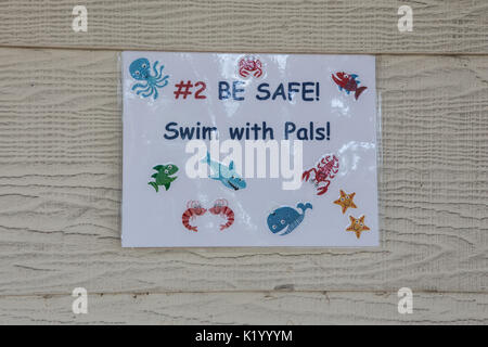 Swimming pool signs informing children to be healthy and safe - Stock Image