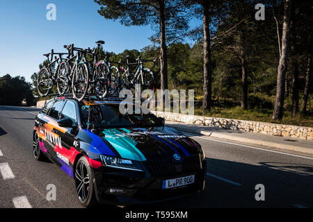 Woman's Cycle race support vehicles La Safor mountains near Gandia Spain - Stock Image