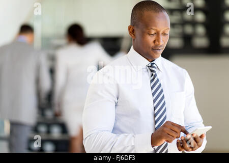 successful African business man using smart phone - Stock Image