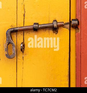 Detail of painted wooden door, Suomenlinna, Helsinki, Finland - Stock Image