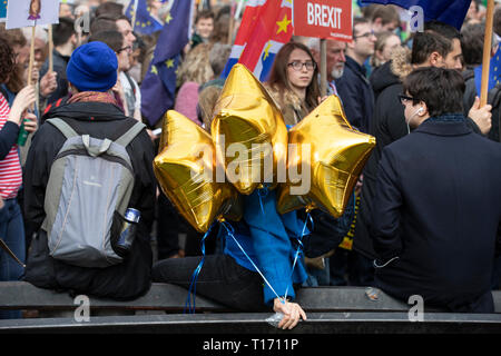 Marcher with three gold star balloons, People's Vote March, London, England - Stock Image