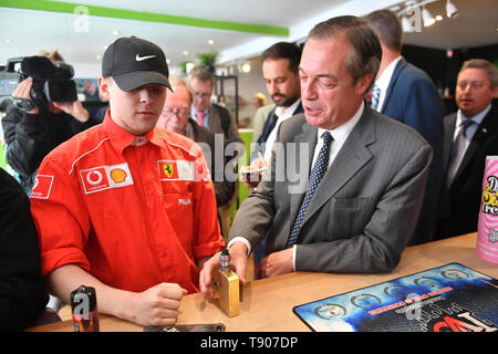 Brexit Party leader Nigel Farage visits a vape shop during a walkabout in Merthyr Tydfil, Wales. - Stock Image