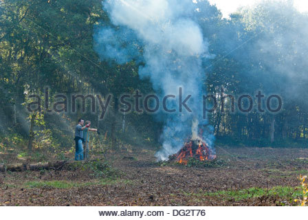 Volunteers with the Yorkshire Wildlife Trust clear brushwood in Potteric Carr Nature Reserve, South Yorkshire, England. - Stock Image