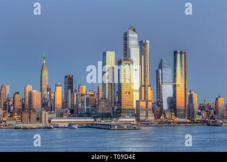 The mixed-use Hudson Yards real estate development and other buildings on the West Side of Manhattan in New York City at twilight. - Stock Image