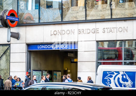 LONDON - NOVEMBER 13 : Entrance to London Bridge underground station. The red circular logo with the outdoor on 13 November 2018 in London, England UK - Stock Image