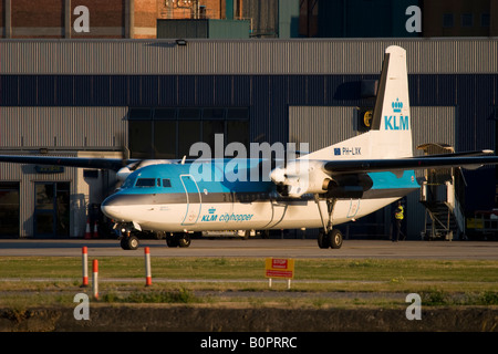 Commercial aircraft Fokker 50 KLM taxiing at London City Airport, England, UK - Stock Image