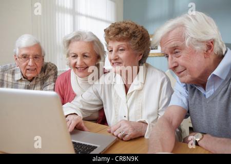 Senior adults using laptop - Stock Image
